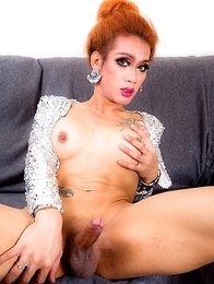 Moo is a sexy tall tgirl with a slim body, big tits, a sexy round ass and a big hard cock! Watch this kinky Asian redhead stroking her big cock!