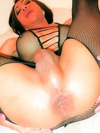 Nana and her Big Cock is barebacked in a black fishnet bodysuit. Nana swings her large dick, stroking her cumfilled knob then presents her well-traine