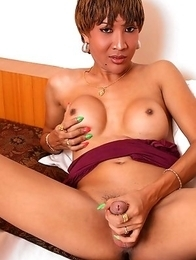 Mature Ladyboy Oa with big curvy ass strokes her hard cock