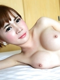 20 year old Thai ladyboy Yuri gets naked and fucks tourist
