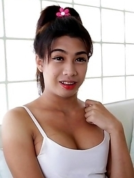 21yo busty Thai shemale Bam does a striptease for the camera