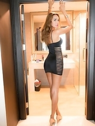Nattcha is ultra sexy in a slit-cut black miniskirt. Proped up in hells and wearing no panties makes Nattcha the ultimate post-op sex machine.