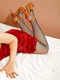 Japanese Newhalf Mana is so seductive in red, with her tight fishnet stockings and heels.