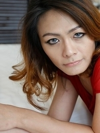 Thailand ladyboy Teena with sexy eyes and white cock in her mouth