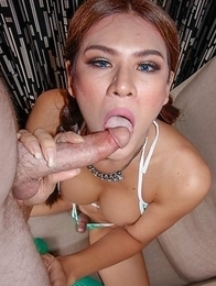 Shapely Ladyboy Taan has on a green bikini with striped socks. After giving the POV a glimpse of her big tits, she has a seat on her nice round ass an