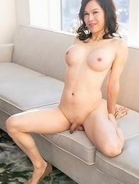 Busty ladyboy Mimi shows her shaved cock and big ass