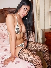 Ladyboy LinLin X multitude is covered in lately a revealing gold bikini.